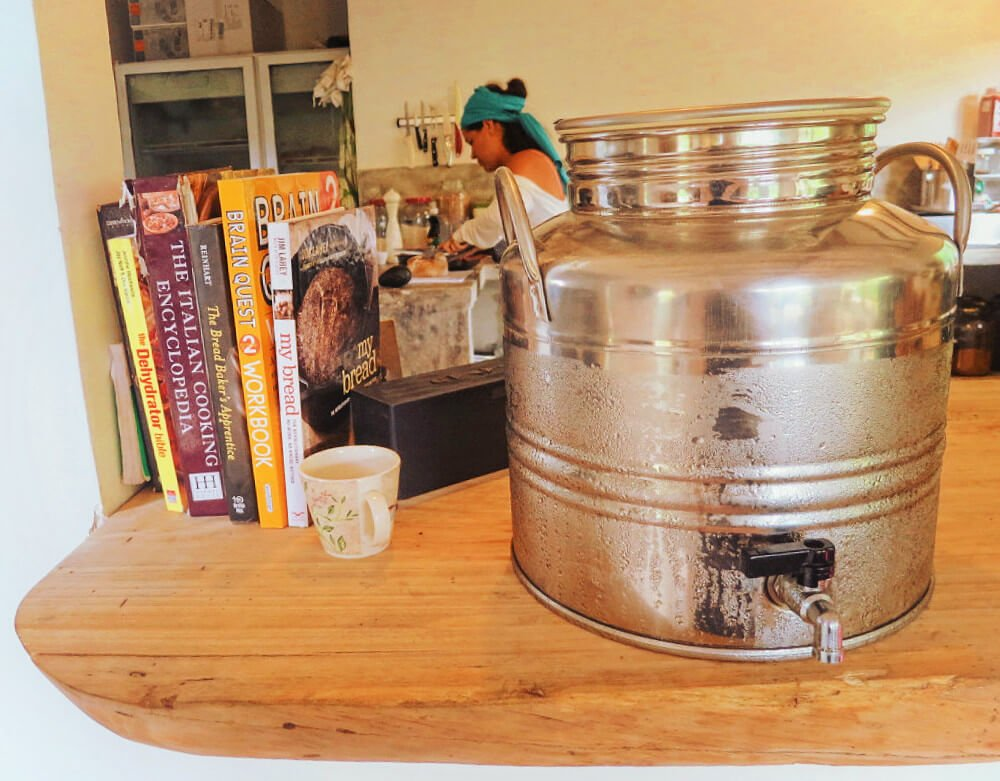 Carefully selected books and ice cold purified water in Duni, Minca', Colombia's only artisanal bakery.