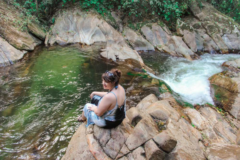 Lia in her happy place at Pozo Azul in Minca, Colombia.