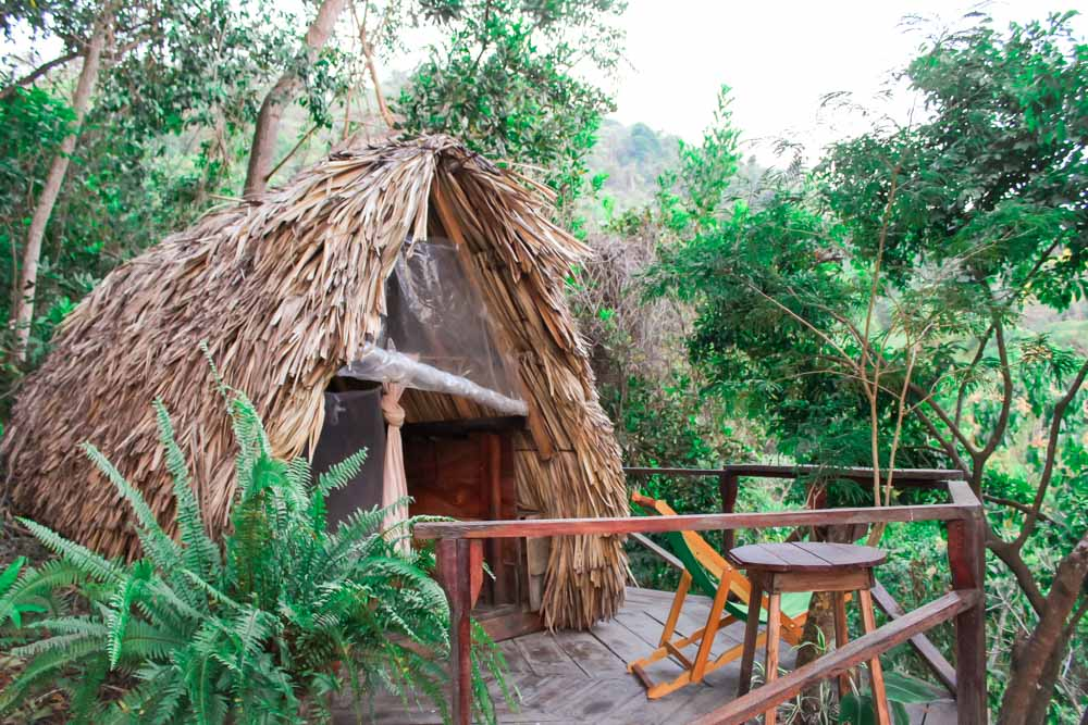 One of the beautiful private thatched roof huts at our favorite hostel in Minca, Casa Loma!