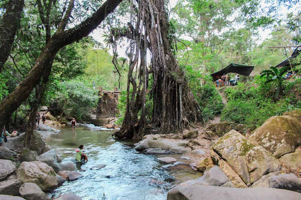 Beautiful Pozo Azul is a serene swimming hole tucked in the lush jungle of Minca, Colombia.