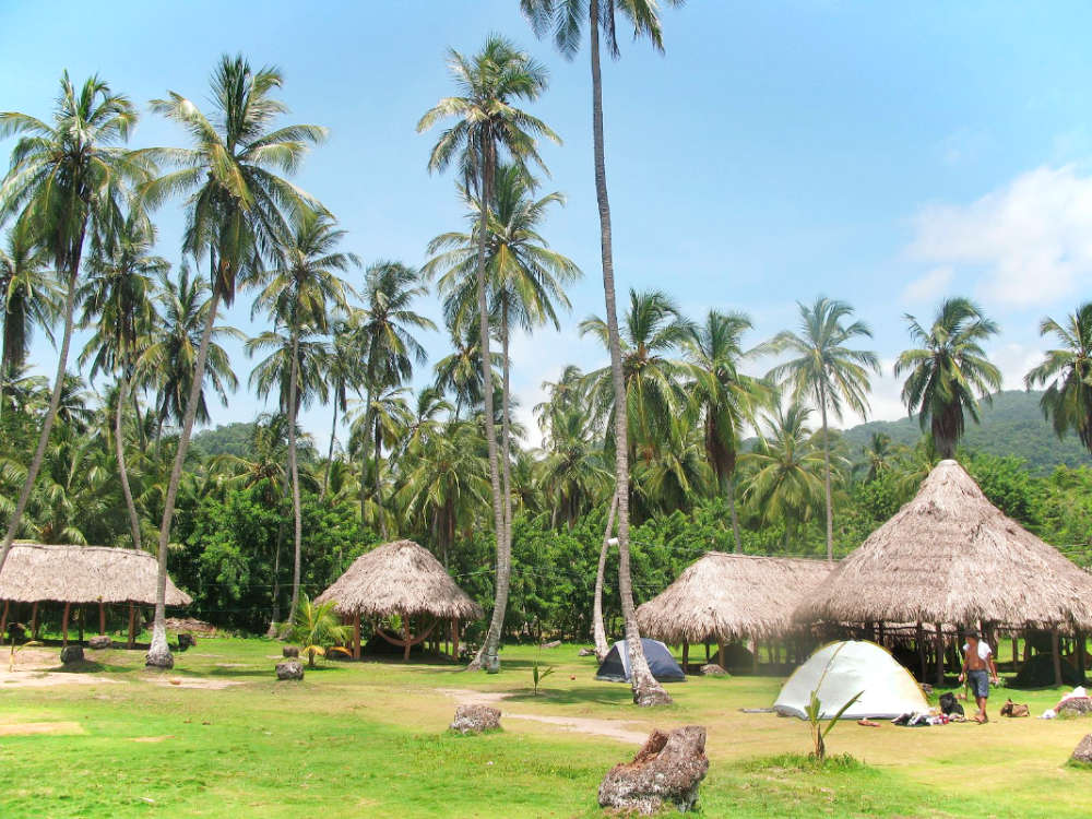 The campgrounds in Parque Tayrona. They're not fancy, but if you can get down with some rugged hammock camping, they're a great budget option for staying overnight in Parque Tayrona, Colombia.