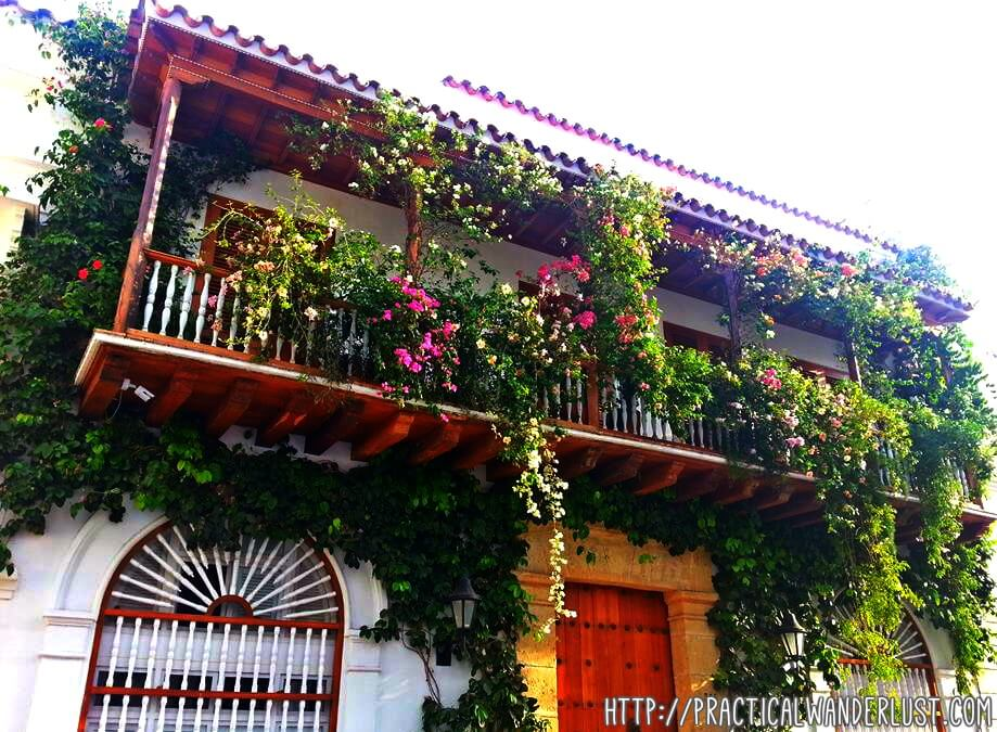 A flower-covered facade in the old Walled City of Cartagena, Colombia.
