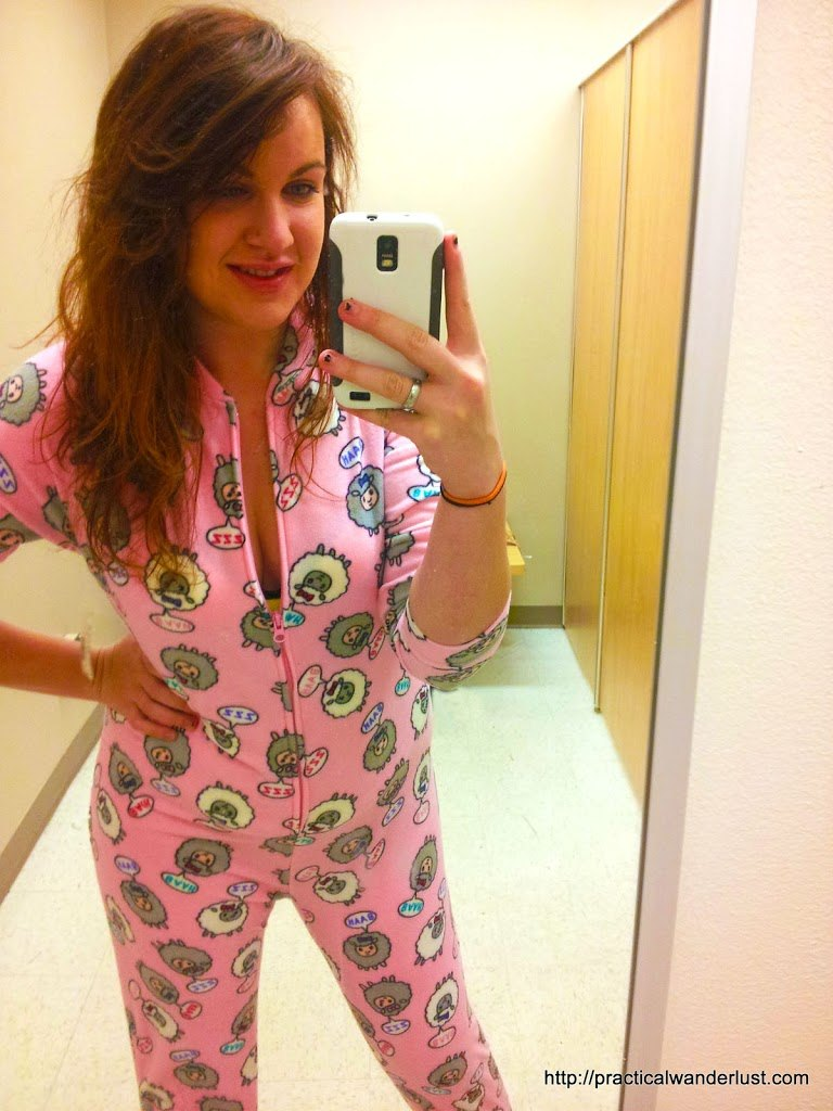 22 year old me wearing a pink onesie with sheep on it.