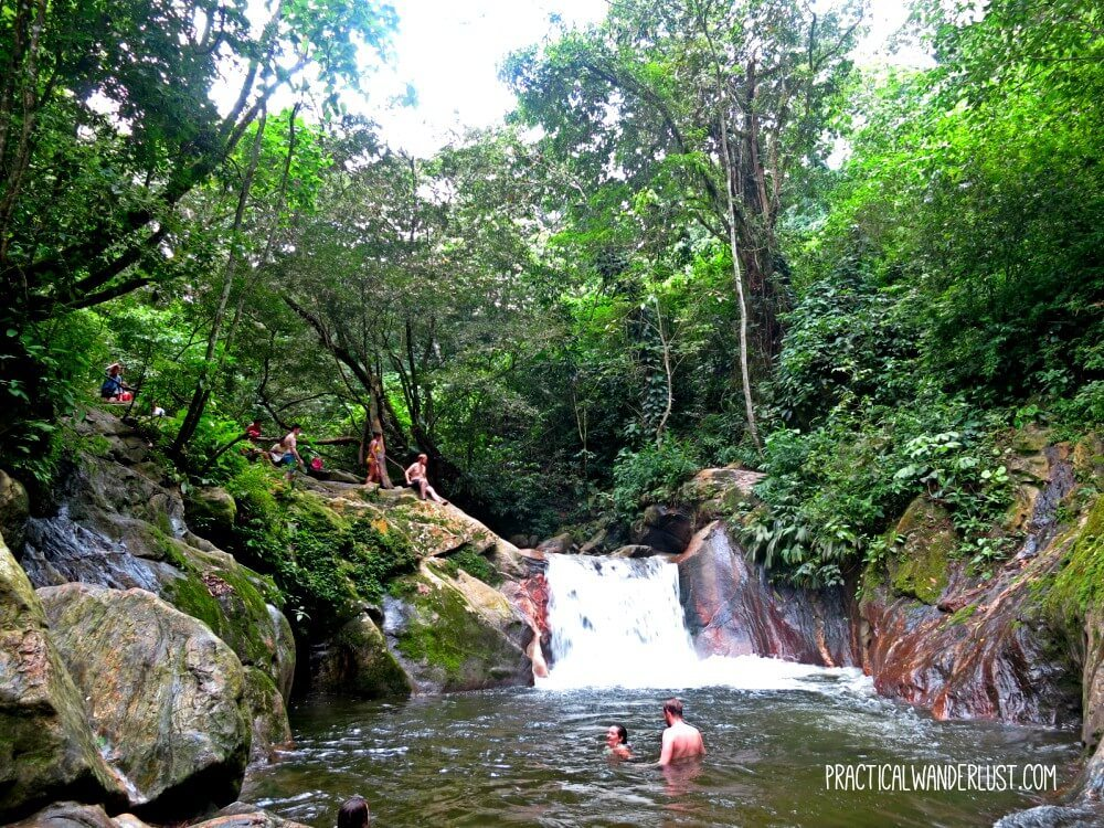 Cliff jumping at Pozo Azul waterfall, about an hour's walk from the town of Minca, Colombia