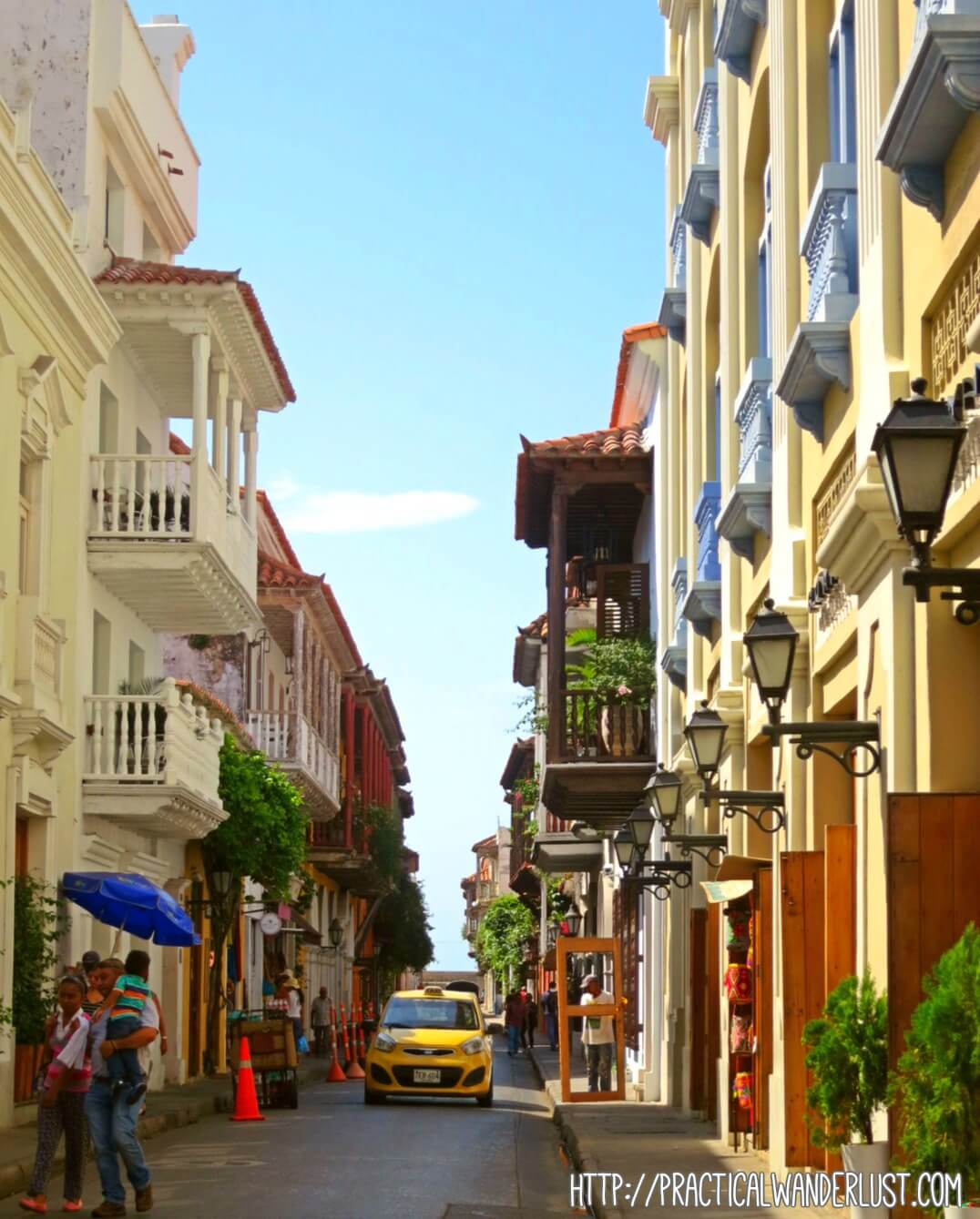 A taxi winding its way through the crowded, curving streets of the old Walled City in Cartagena, Colombia.