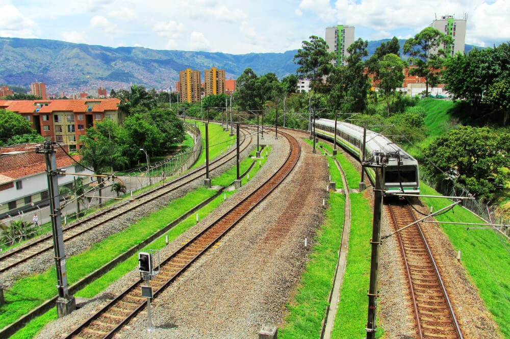 Riding the Metro is the best budget-friendly to take a city tour of Medellin, Colombia. We spent the whole day riding the trains and it cost us under $5!