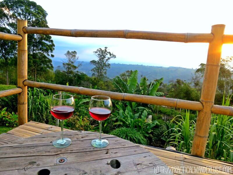 Drinking wine while watching the sun set over the coffee region at La Serrana Hostel in Salento, Colombia