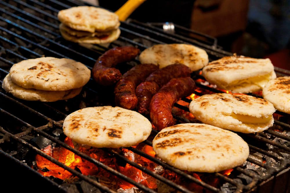 Arepas are one of the most famous street foods in Colombia. They're made with corn masa and griddled on smoking coals on the street. Our favorites were stuffed with cheese and meat and oozing with hot, melty deliciousness.