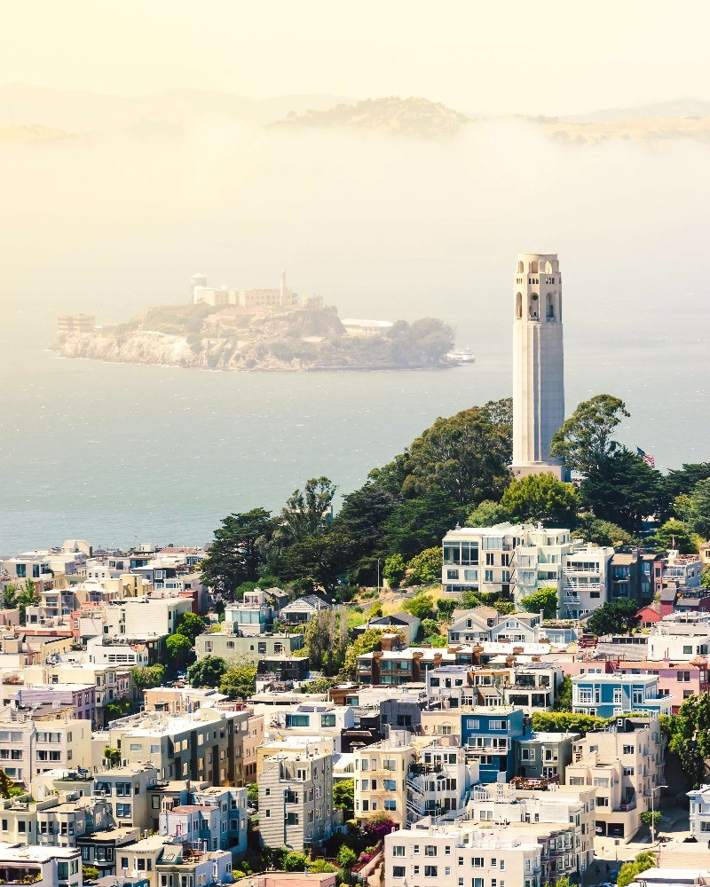 Overlooking Coit Tower & Alcatraz in San Francisco, California. On your self-guided walking tour of San Francisco, you'll actually be walking right past Alcatraz and climbing up to Coit Tower!