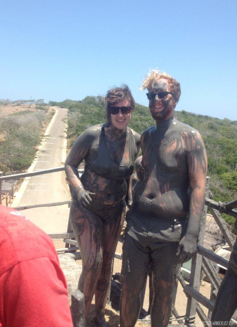 Covered in mud after a mud bath in Volcan Tutumo, a dormant volcano, outside of Cartagena, Colombia.