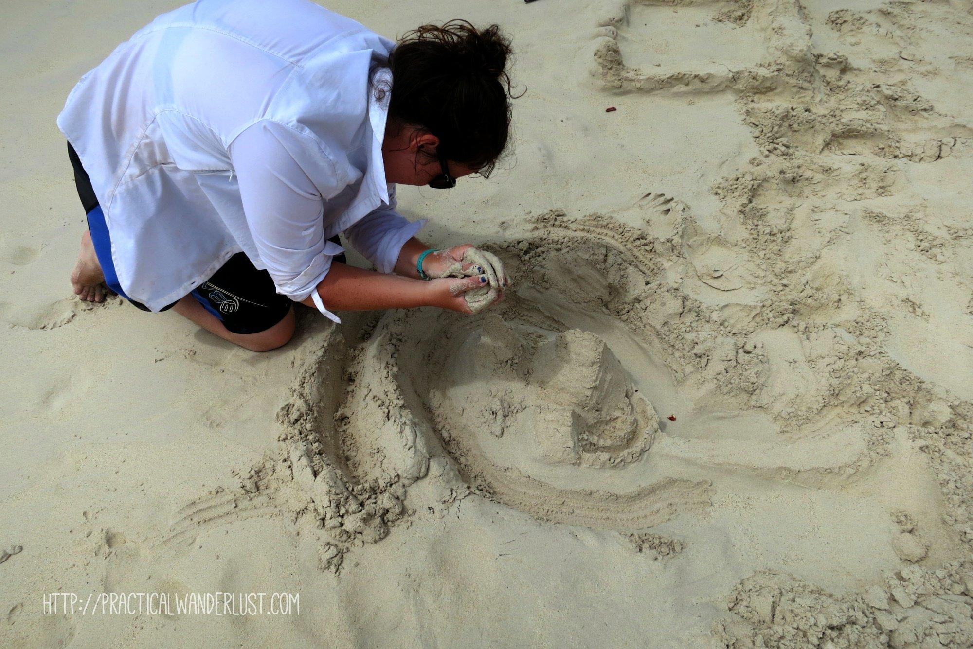 building a sandcastle on Santa Cruz in the Galapagos