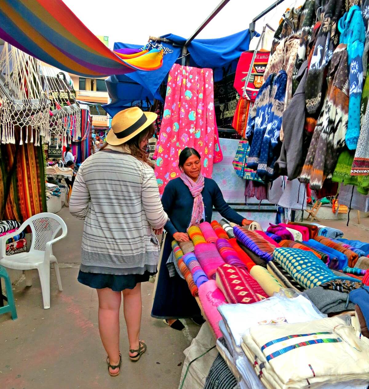 Shopping at Otavalo Market in Ecuador. We didn't realize you shouldn't buy alpaca products in Ecuador. Just another one of the things nobody told us about traveling to Ecuador!