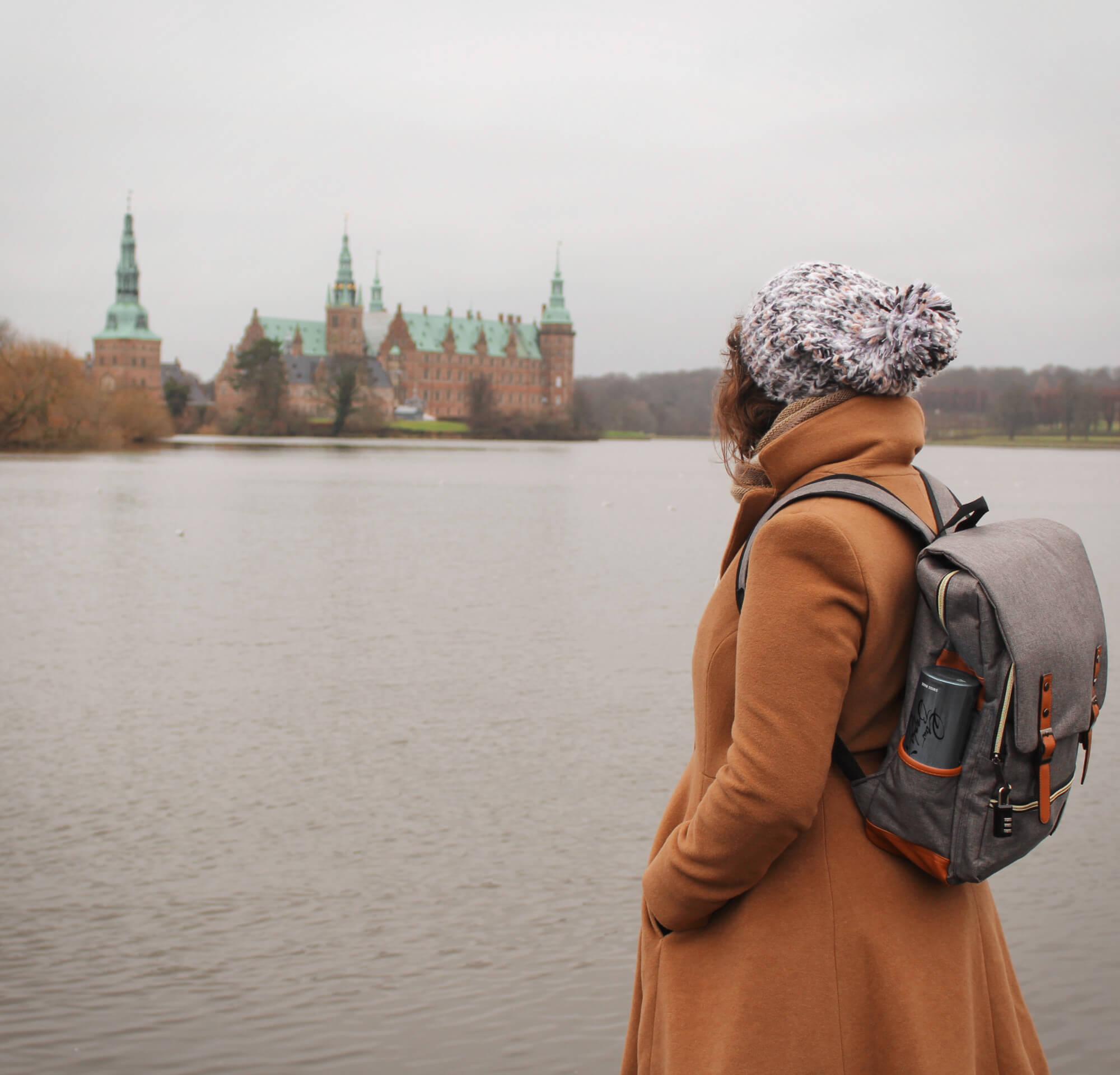 Gazing at fairytake Frederiksborg Castle outside of Copenhagen, Denmark in the winter.
