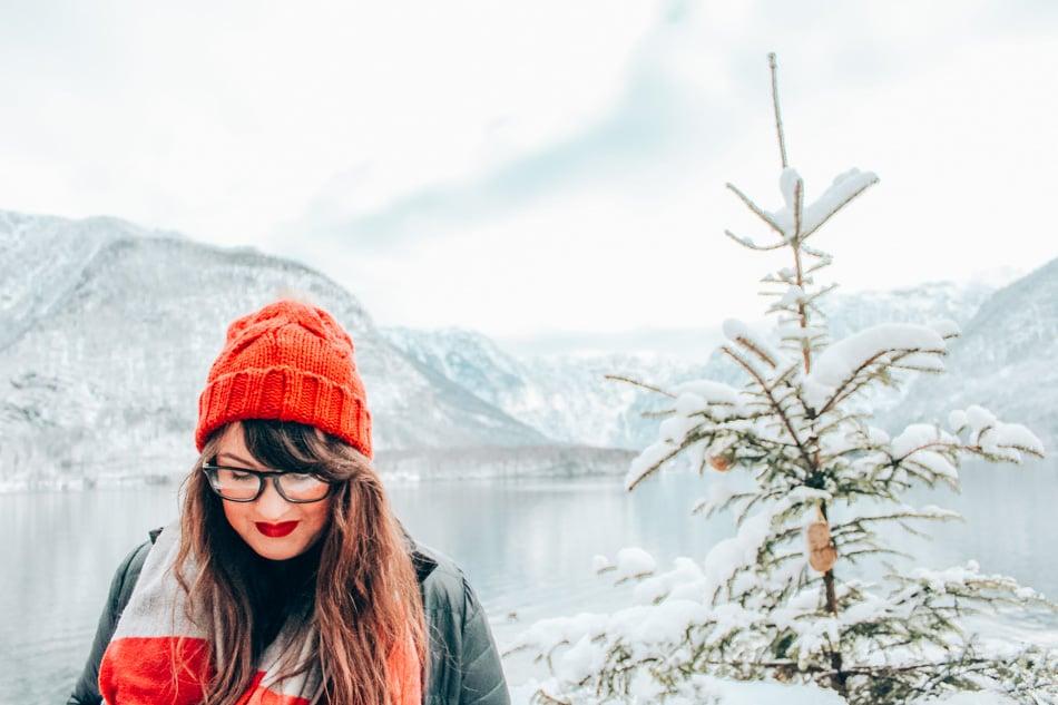 Lia in red lipstick on a snowy day in Hallstatt, Austria