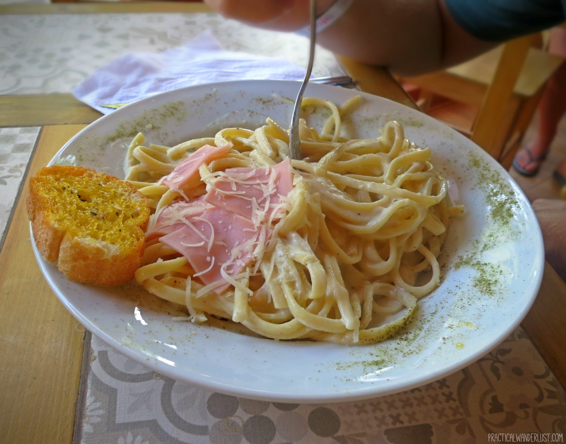 Lunch meat and alfredo pasta in Huacachina, Peru. Lunch meat on pasta is one of the things nobody told us about Backpacking in Peru!