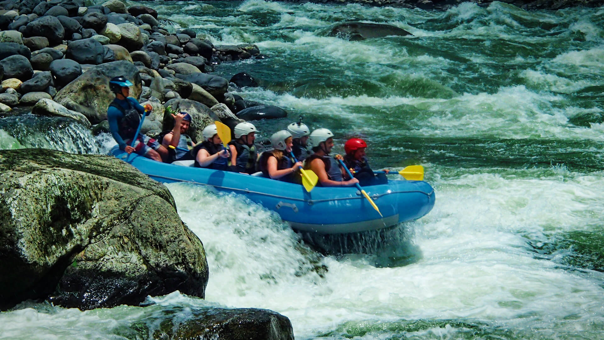 White water rafting on class IV rapids in the adventure town of Baños, Ecuador!