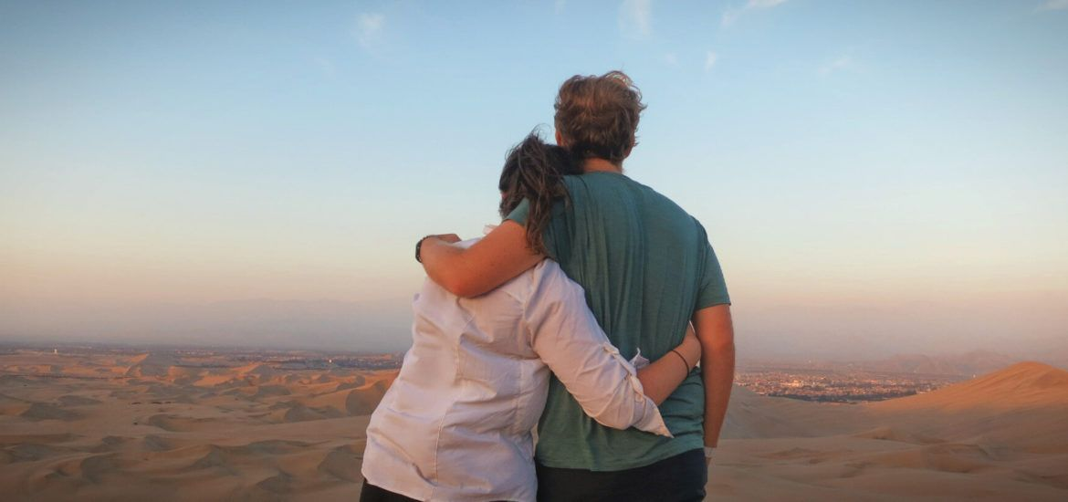 Huacachina, Peru. Gazing at the sunset over the desert dunes and thinking about ending our trip to South America early.