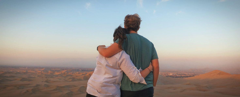 Gazing at the sunset over the desert dunes in Huacachina, Peru.