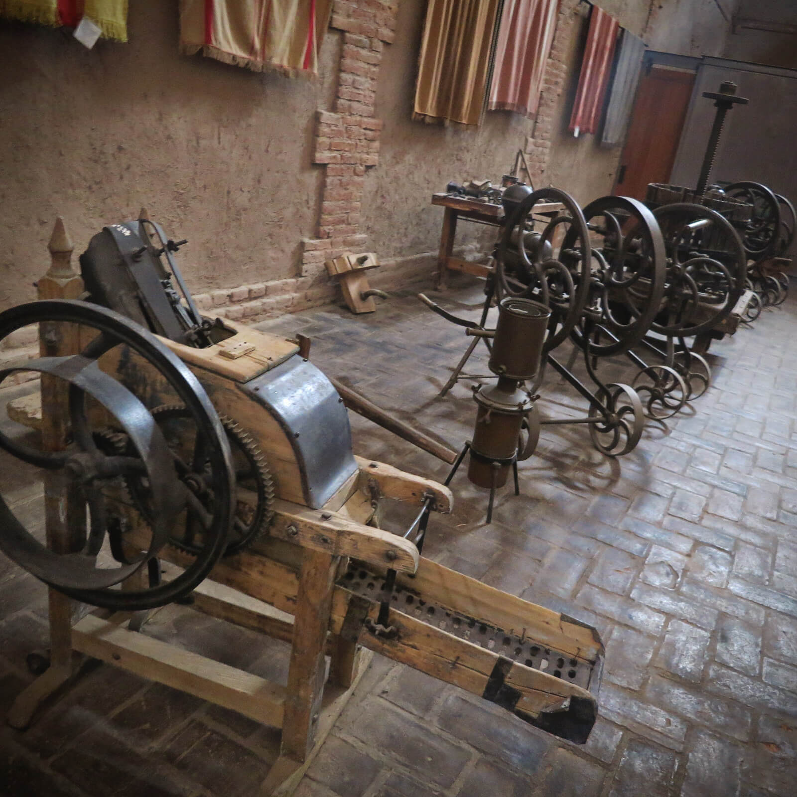 Ancient wine machinery and historical ponchos on display in Mendoza, Argentina during our tour with Mendoza Wine Camp.