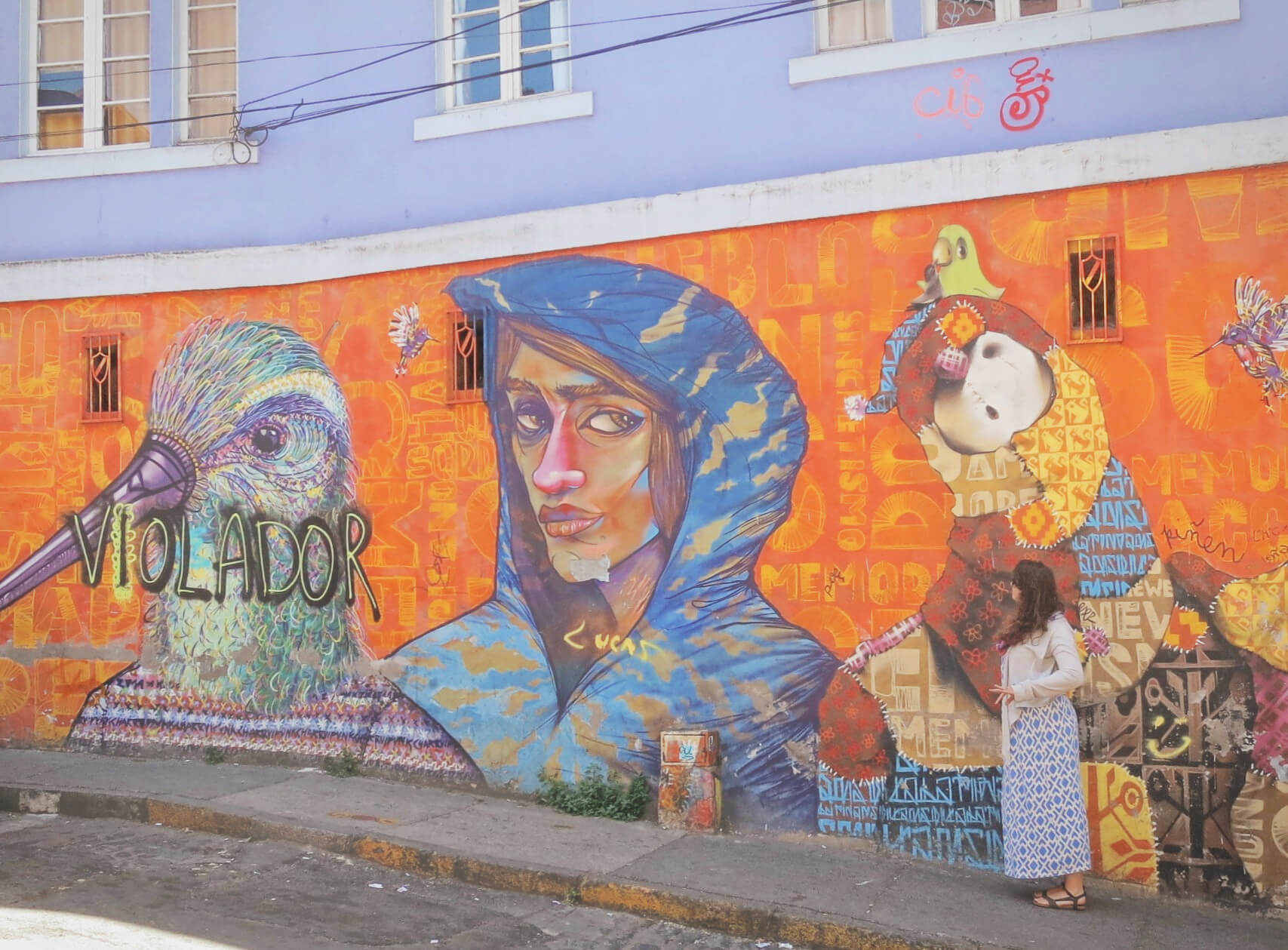 Admiring the street art in Valparaiso, Chile. Find out what to pack for South America travel.