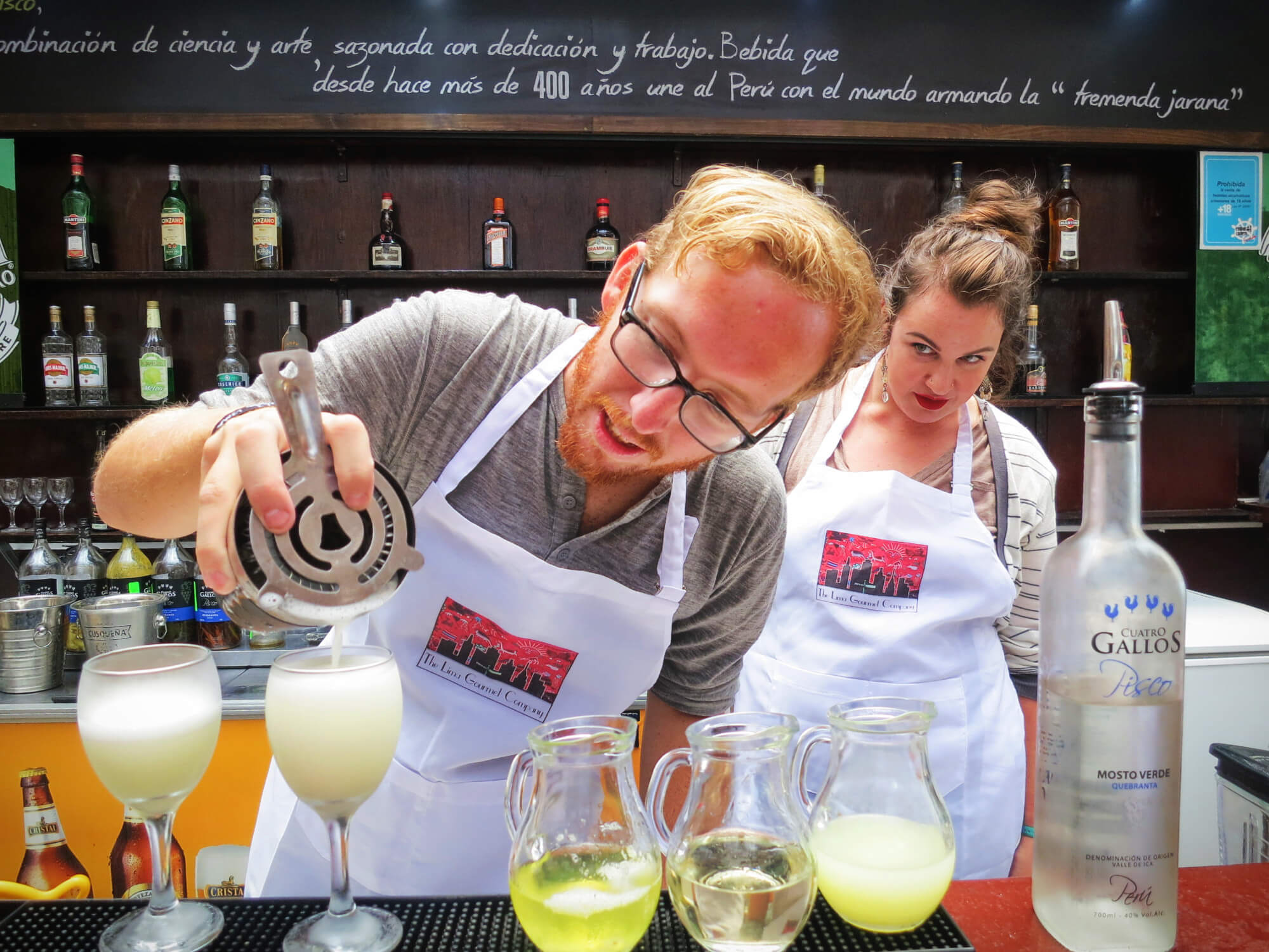 Carefully making a Pisco Sour in our cooking class with Lima Gourmet in Lima, Peru.