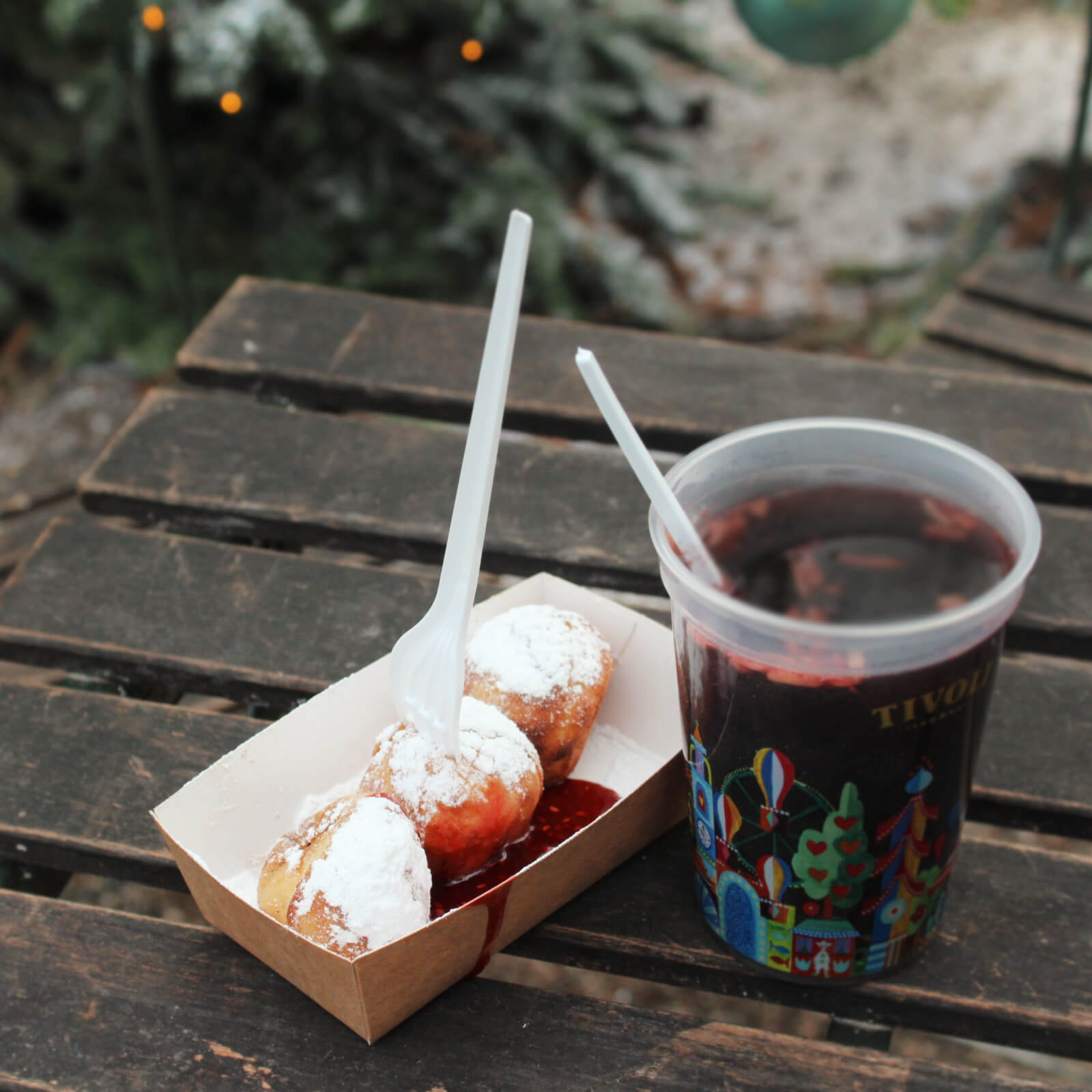 Aebleskiver are little balls of pancake deliciousness served with jam. One of our favorite Copenhagen Christmas Market food finds!