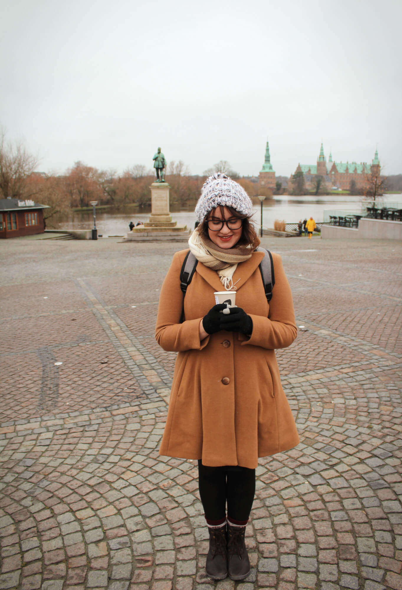 Hygge and free hot chocolate in front of Frederiksborg Castle in Copenhagen Denmark.