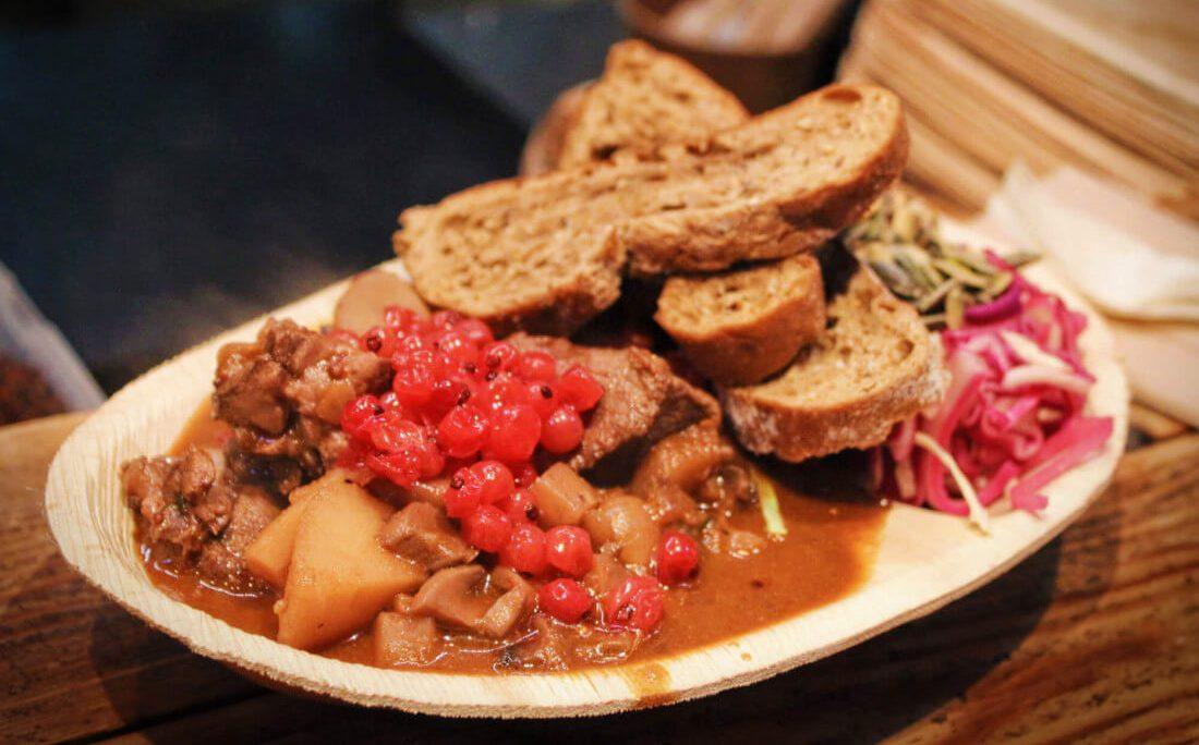 Venison stew from Paper Island Street Food Market in Copenhagen. The perfect warm Danish stew for a chilly winter in Copenhagen. One of the best foods to eat in Copenhagen in the winter!