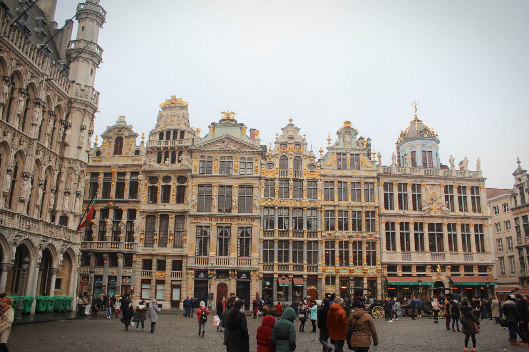 The stunning Grand Place in Brussels, Belgium, the most beautiful plaza in Europe! Note the multiple styles of architecture - Gothic in the left, gold studded baroque in the center. The Grand Place is home to several different styles of architecture.