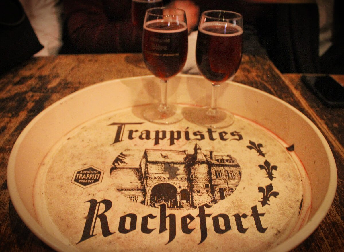 Drinking a delicious Kriek Lambic beer off of a Trappistes Rochefort tray. 2 famous Belgian Beers at once!