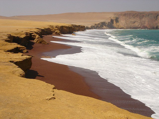 "The red sand beaches in Paracas, Peru, near the the Islas Ballestas, said to be the ""Poor Man's Galapagos Islands."""