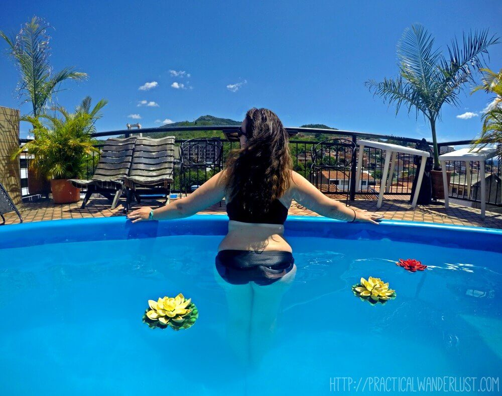 Relaxing in the rooftop pool at Sam's VIP Hostel in San Gil, Colombia. One of the best hostels in Colombia!