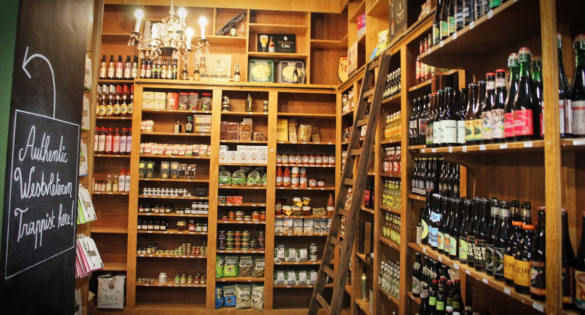 Beer stores in Brussels are both places to buy beer and places to drink beer. And places to climb up little ladders and peer at dusty old beer labels.
