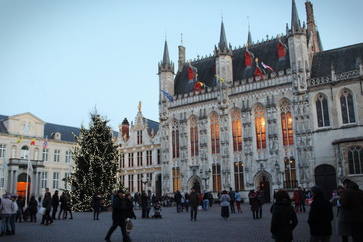 The gorgeous Burg Central Plaza with a Christmas tree in Brugges, Belgium in winter.