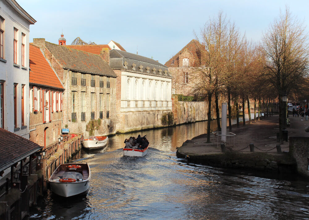 Cruising down the canals of Brugges in a little skipper boat is a fun way to explore the medieval city! Bundle up if you're in Brugges in winter.