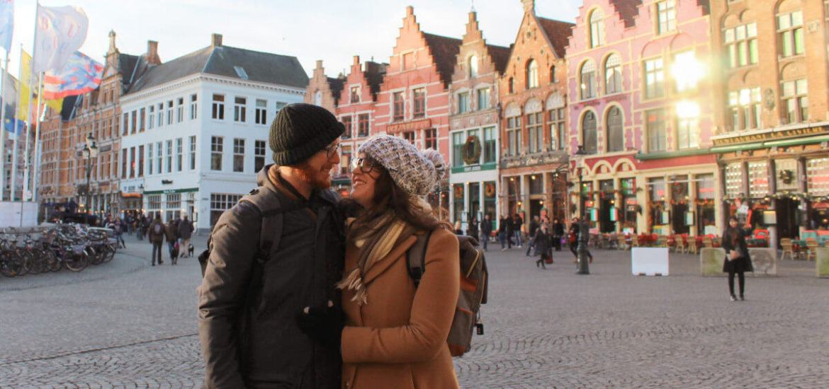 Couple in romantic Bruges in winter.