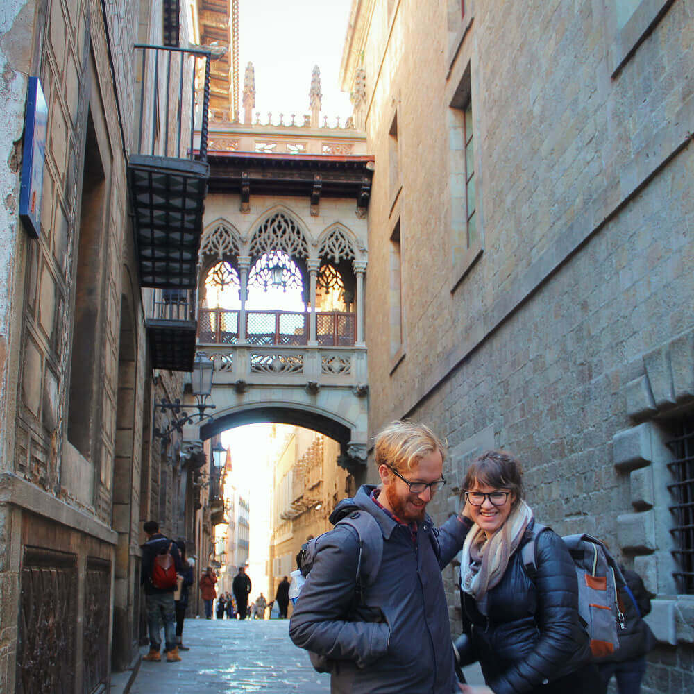 Travel Couple in the gothic quarter in Barcelona, Spain.
