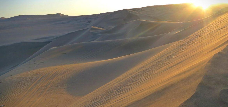 Sunset on the dunes in Huacachina, Peru.