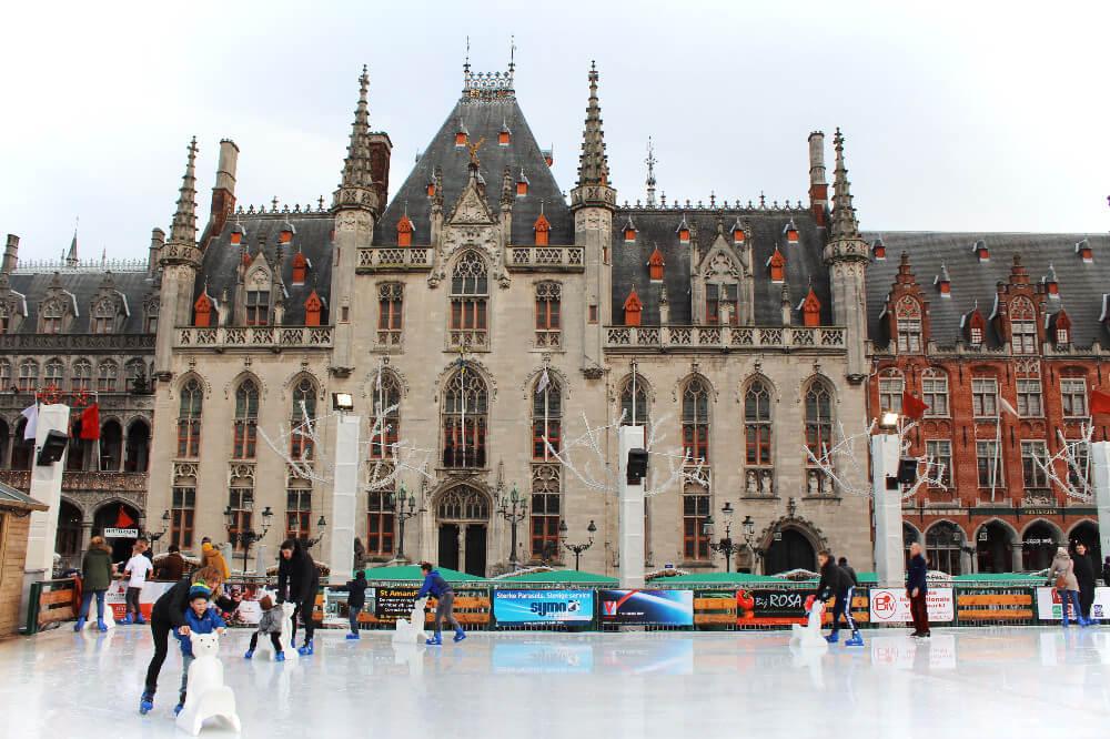 Ice Skating in Markt Square in romantic Brugges, Belgium in the winter.