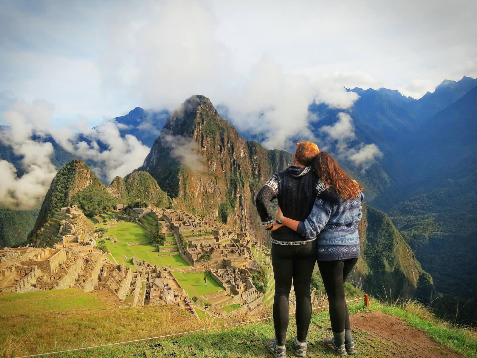 Couple overlooking Machu Picchu, Peru