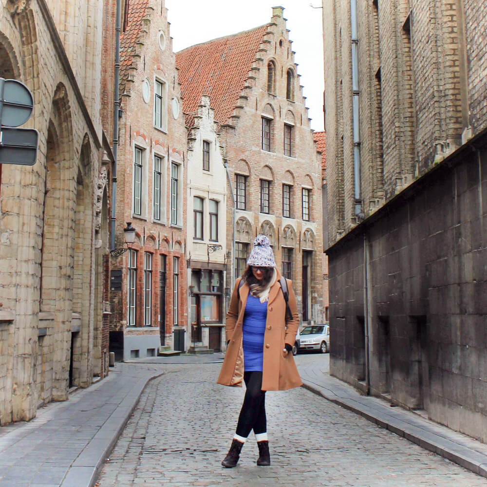 All bundled up in Bruges, Belgium! Bruges in the winter can be quite cold, so be sure to bring layers for warmth.