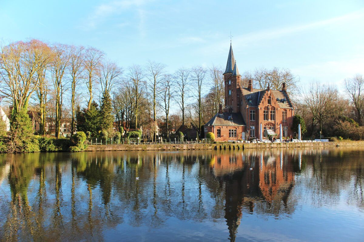 Stunning Minnewater Park and the Lake of Love in romantic Brugges, Belgium, in winter.