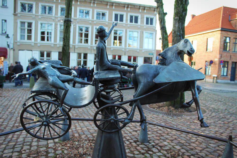 Our favorite statue in Bruges, Belgium. Drunk carriage rides, anyone?