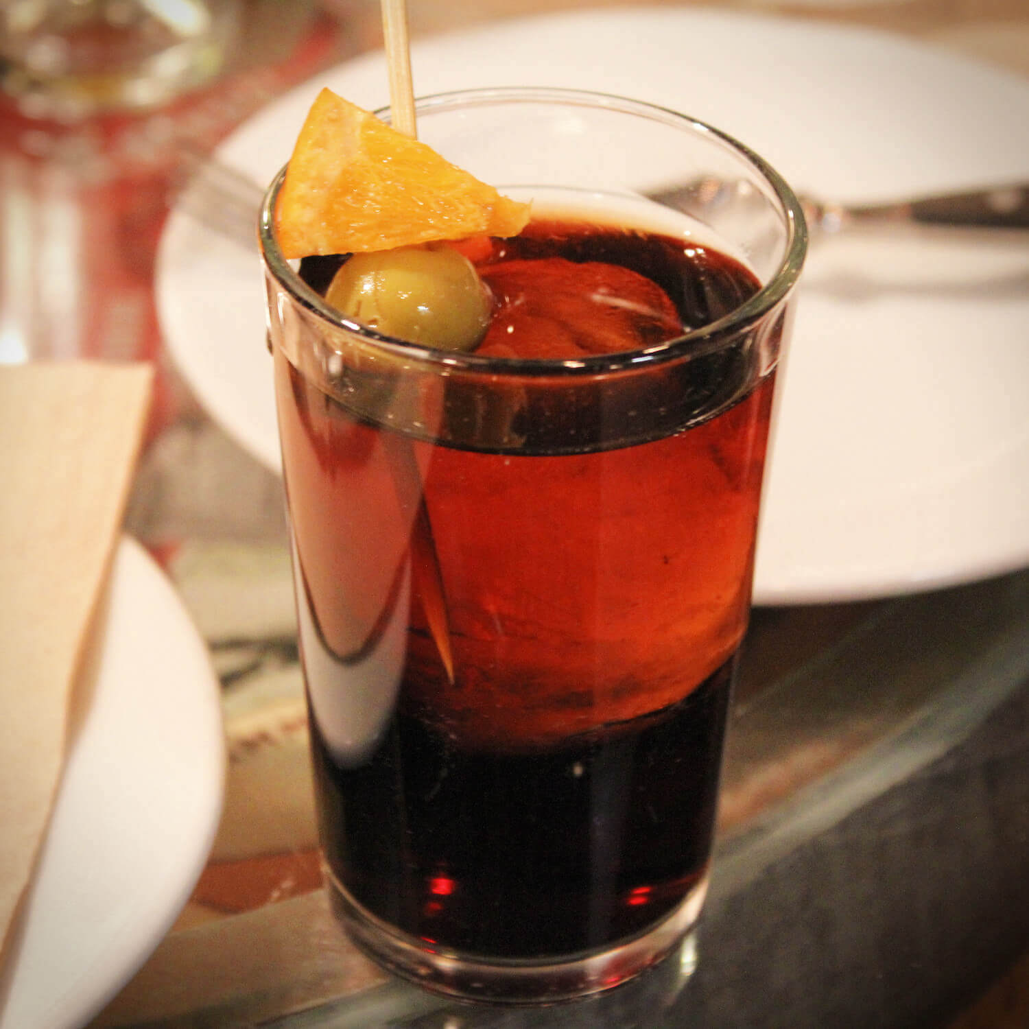 Delicious sweet Vermouth is traditionally drunk straight in Spain, with a salty olive and an orange as garnish. We enjoyed this along with other Spanish wines on the Devour Barcelona wine tasting and tapas food tour!