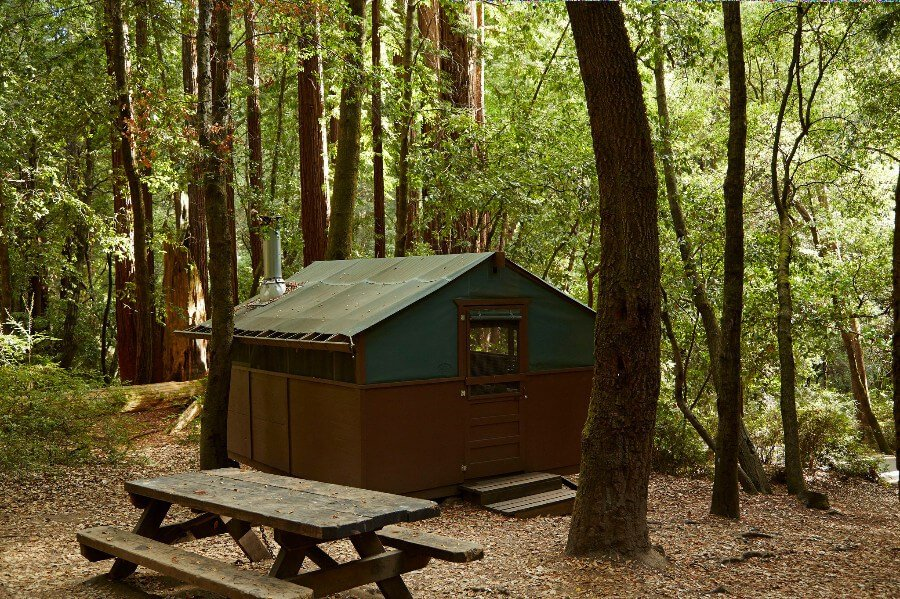 The rustic Tent Cabins at Big Basin State Park are surrounded by majestic, towering redwoods. Never been camping before? The tent cabins are the perfect place to stay near San Francisco!