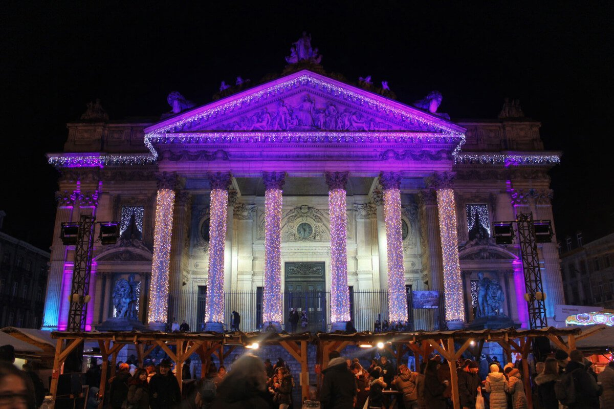 The Brussels Stock Exchange lit up at night during Christmastime in Brussels, Belgium.