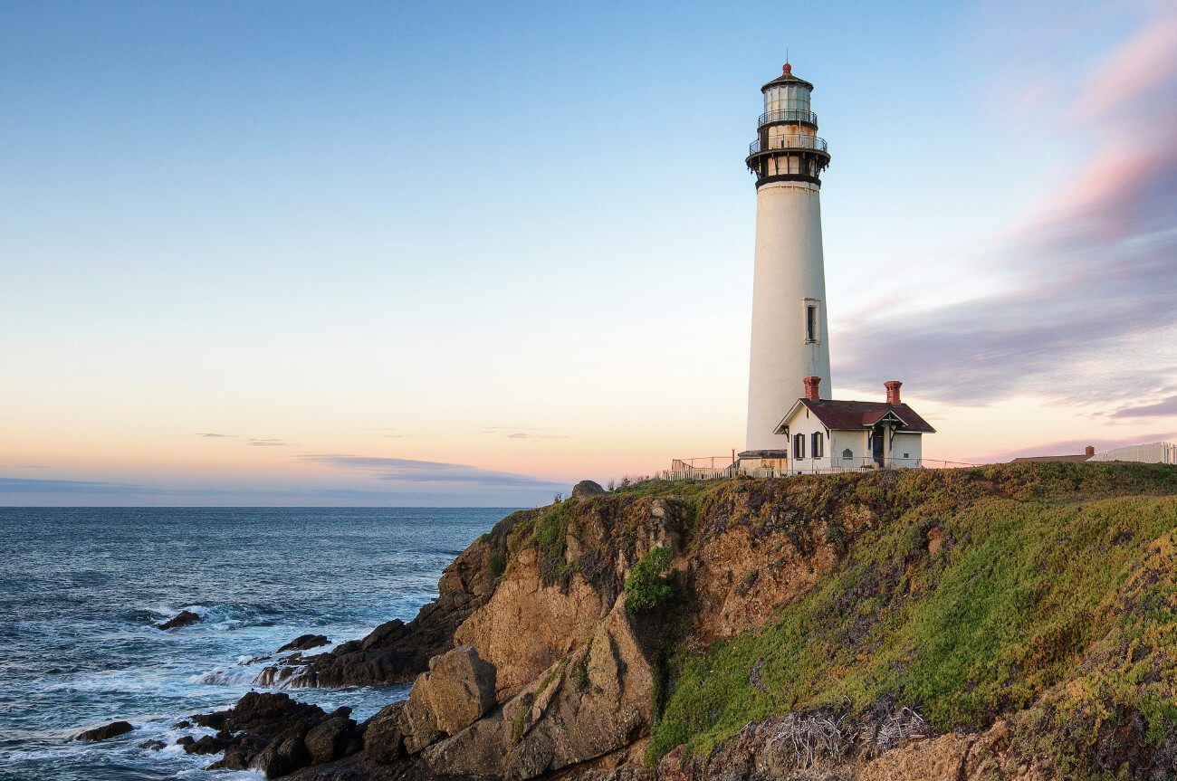 Iconic Pigeon Point Lighthouse Hostel in Pescadero, California. Watch the sun set over the Pacific ocean in a cliffside hot tub ... for only $31 a night. See why we love hostels so much?!