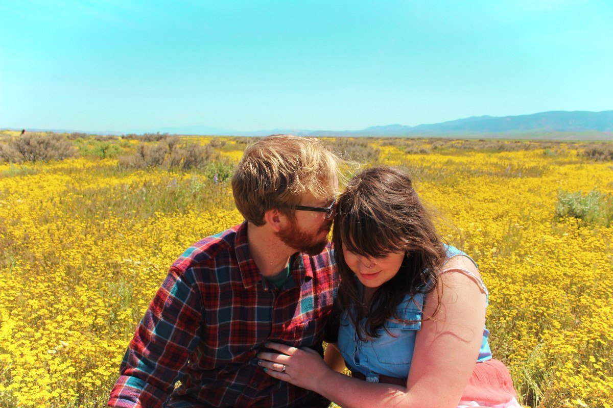 Travel couple at Carizzo Plain superbloom in California, USA
