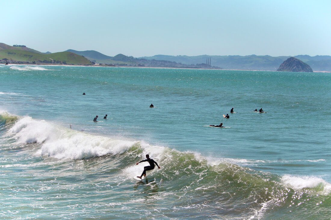 Surfers in Cayucos, California on the central coast