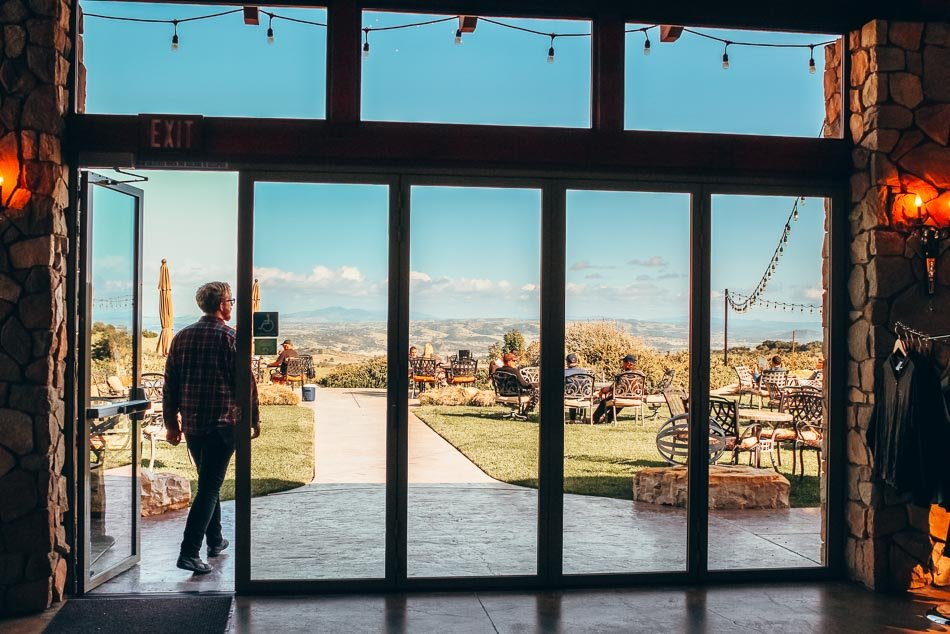 Walking out onto the patio at Calcareous Winery in Paso Robles, California.